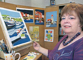 photograph of marilyn spence with her paintings